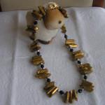 Art.-Nr. 520 Bergkristallstifte, facettierte Hämatitkugeln 4mm, facettierte Onyxkugeln 8mm, vergoldeter Kupfer-Karabinerverschluss, 59,00€