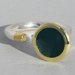Art.-Nr. Ca- RS1375TL Silberring teilvergoldet | Open Swirll, 10 mm fac. London blue Topas, 298,00€